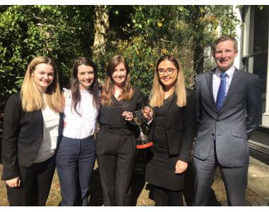 Sam Corbett A and L presenting the cup to the IPLS team comprising of Eimear Cathcart, Allison Weir, Hayley Cummings & Amanda Gilliland.