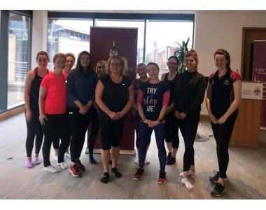 President Suzanne Rice with pilates class attendees
